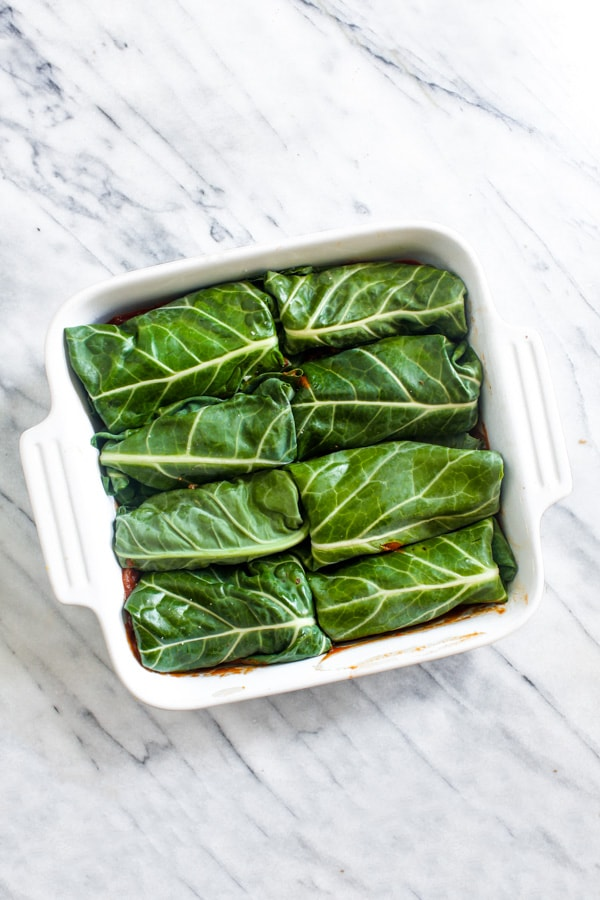 Fall Harvest Collard Rolls with Cranberry Tomato Sauce is a healthy recipe filled with butternut squash, pecans, and creamy almond ricotta. A vegan, paleo, and gluten-free Thanksgiving recipe that everyone will love! | CatchingSeeds.com