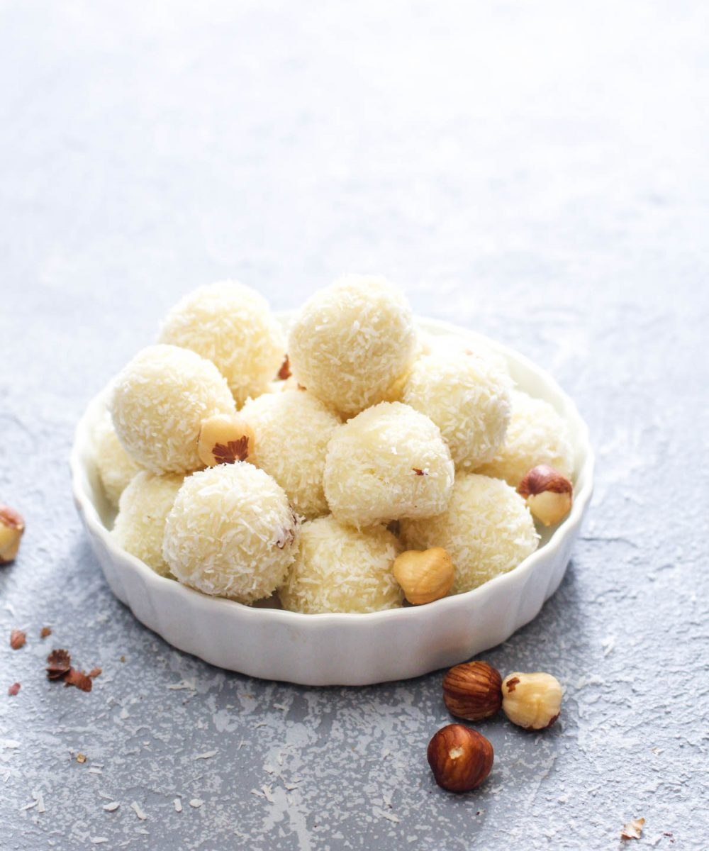 White Chocolate Hazelnut Truffles are a 5-ingredient sweet dessert that is allergy friendly! The melt-in-your-mouth white chocolate is paired with a crunchy nutty hazelnut center. The perfect addition to your Christmas cookie tray.   CatchingSeeds.com