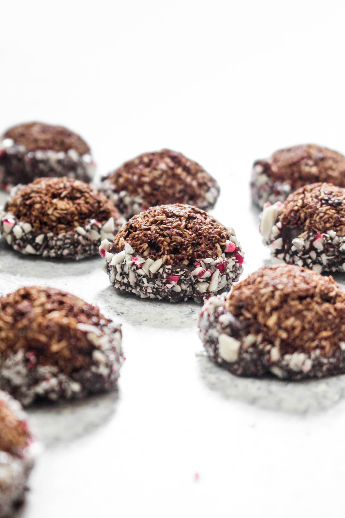 Chocolate Peppermint Macaroon Cookies are an easy 4 ingredient recipe that is made with wholesome and healthy ingredients! An optional dunk in chocolate and crushed candy canes makes these cookies a decadent dessert! | CatchingSeeds.com