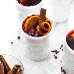 Crock Pot Hot Spiced Wine is an easy 5 ingredient Christmas cocktail. Red wine gets infused with cinnamon, clove, orange, and pomegranate all in the slow cooker for an impressive hands off holiday drink. | CatchingSeeds.com