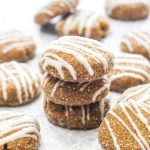 These Soft Ginger Cookies with Eggnog Glaze are a gluten free and vegan holiday dessert that everyone can enjoy! The soft spiced cookie gets topped with a sweet and creamy glaze. A secret ingredient keeps these cookies soft! | CatchingSeeds.com