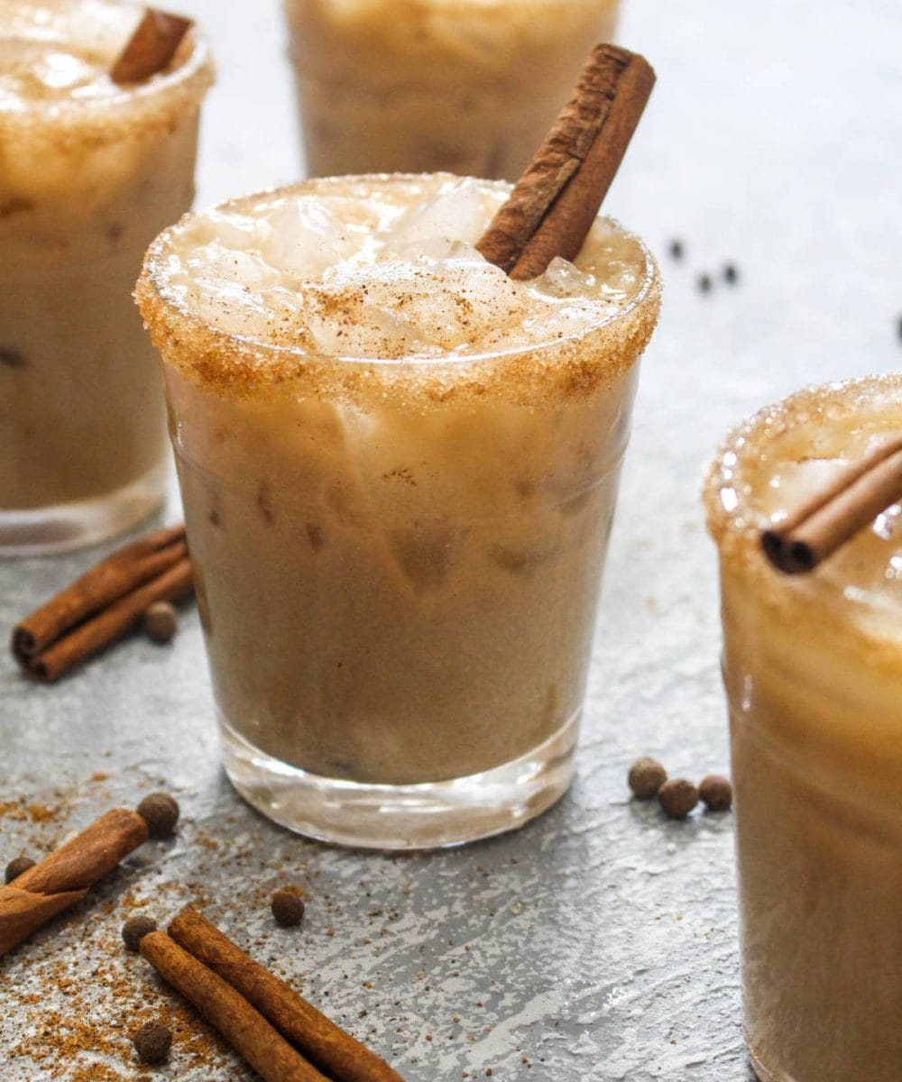 This Almond Spiced White Russian recipe is a fun holiday twist on the traditional cocktail! For a dairy free drink, almond milk gets steeped with spices like cinnamon and nutmeg to infuse this beverage with flavor. | CatchingSeeds.com