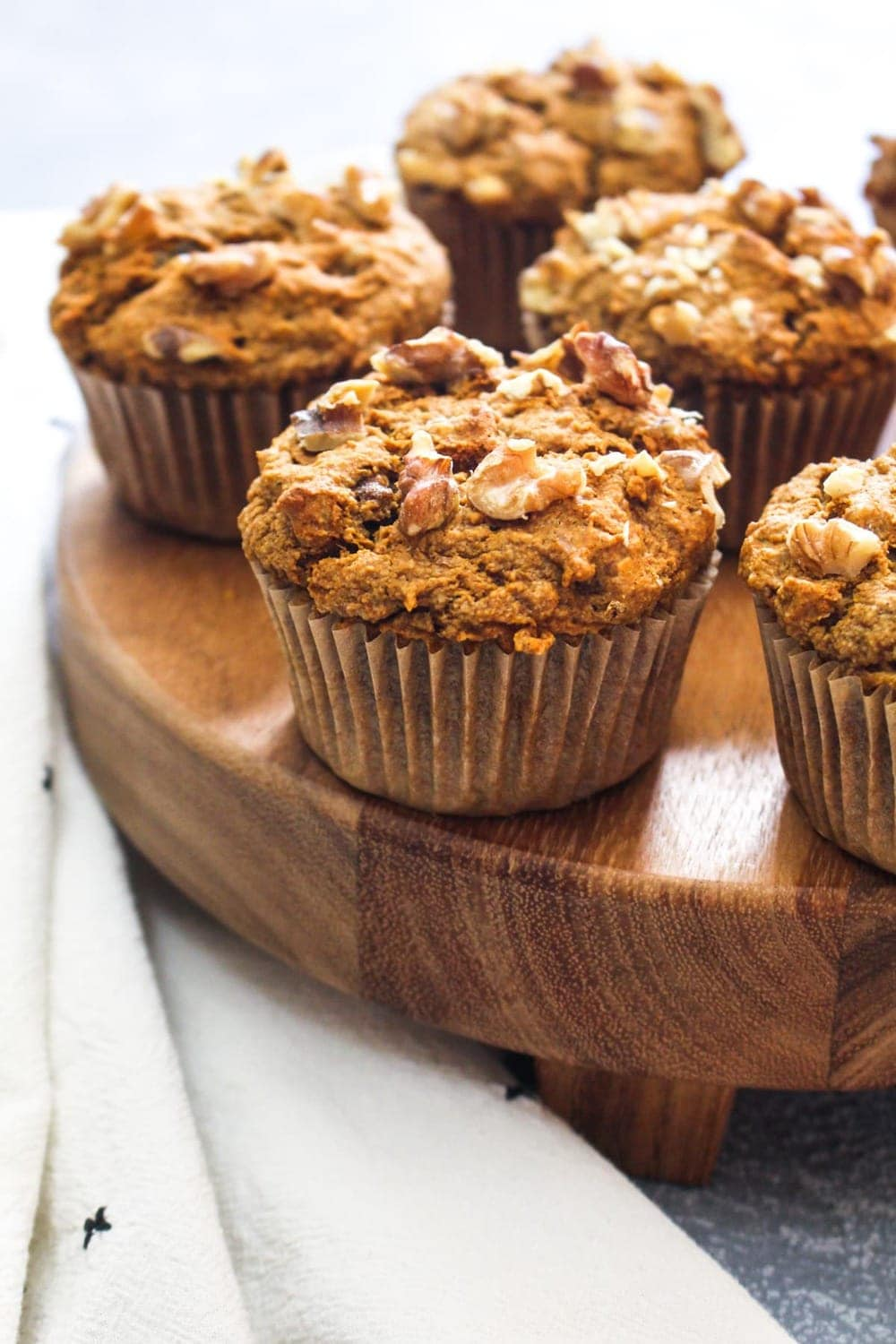 Gluten Free Morning Glory Muffins are a soft and tender pastry that is filled with flavors including nuts, dried fruit, orange zest, and carrots. This recipe is made with whole grains and natural sweeteners for a satiating breakfast or snack! | CatchingSeeds.com