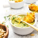 Detox Broccoli Cheese Soup with Vegan Cheddar Toasts is a one pot recipe! This light dinner is dairy-free, gluten-free, and uses just a few simple swaps to keep in all the flavor, while making this soup a truly healthy meal. | CatchingSeeds.com