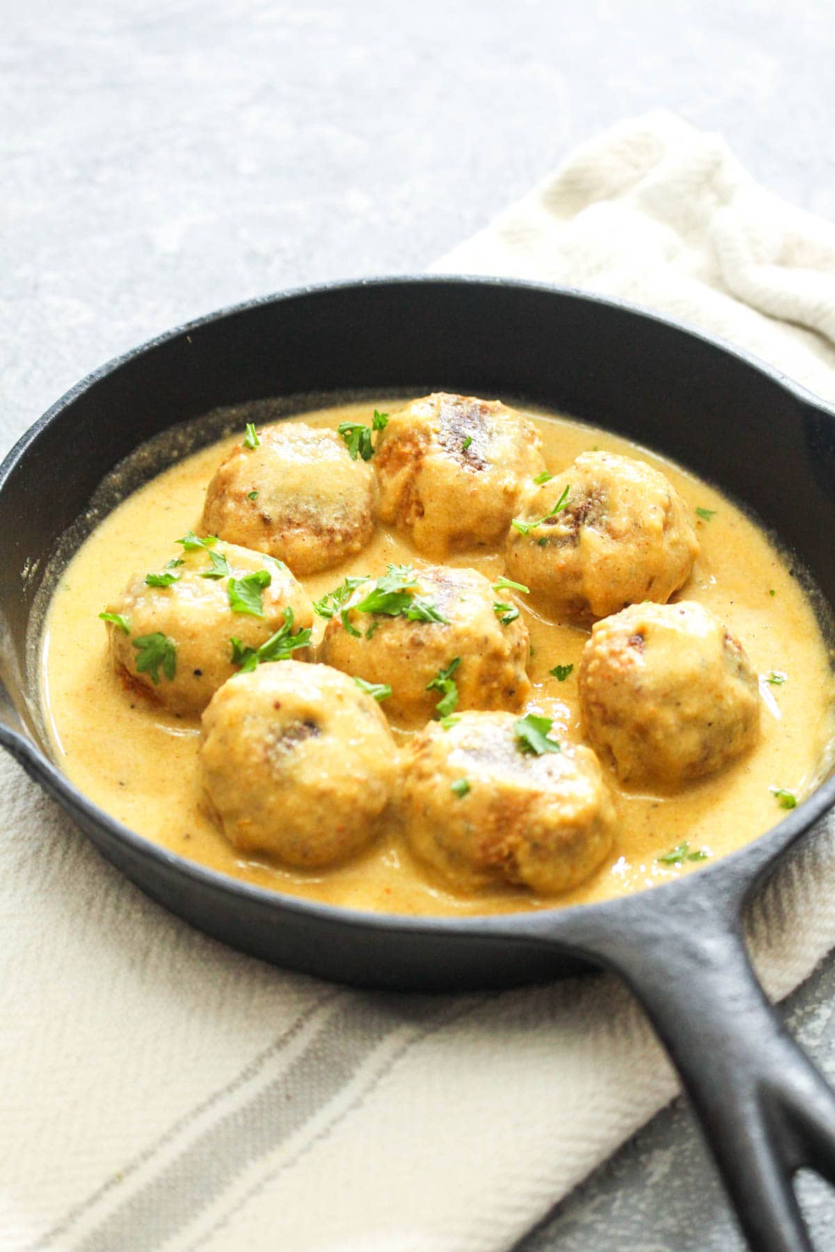 Low FODMAP Adobo Tempeh Meatballs with Chipotle Cream Sauce are a flavor packed gluten-free and vegan recipe! Flavor baked meatballs are combined with a luscious cream sauce for one flavor packed healthy meal. Serve it over rice or veggies for a complete dinner! | CatchingSeeds.com