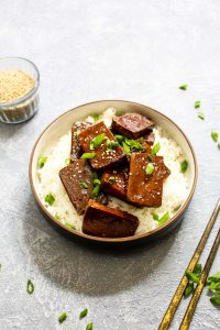 Four ingredientMaple Sriracha Baked Tofu is full of sweet, sticky, and spicy flavor. Marinading the tofu and basting it with a concentrated glaze while it bakes ensures this recipe is loaded with flavor! Vegan, gluten free, grain free, soy free and healthy!   CatchingSeeds.com