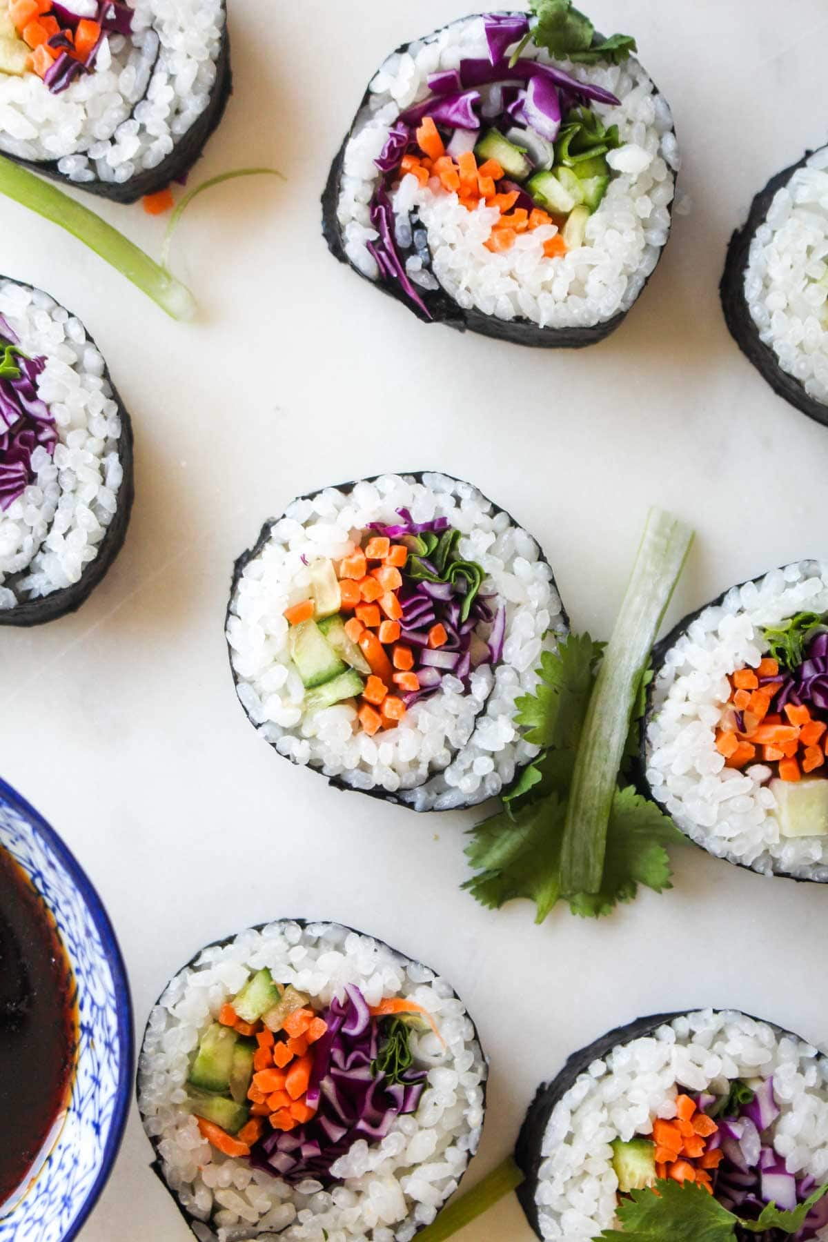 Homemade Veggie Sushi is easier than you think! Customize your roll with your favorite veggies and wow your friends by bringing the sushi bar home with this vegan and gluten free recipe. | CatchingSeeds.com