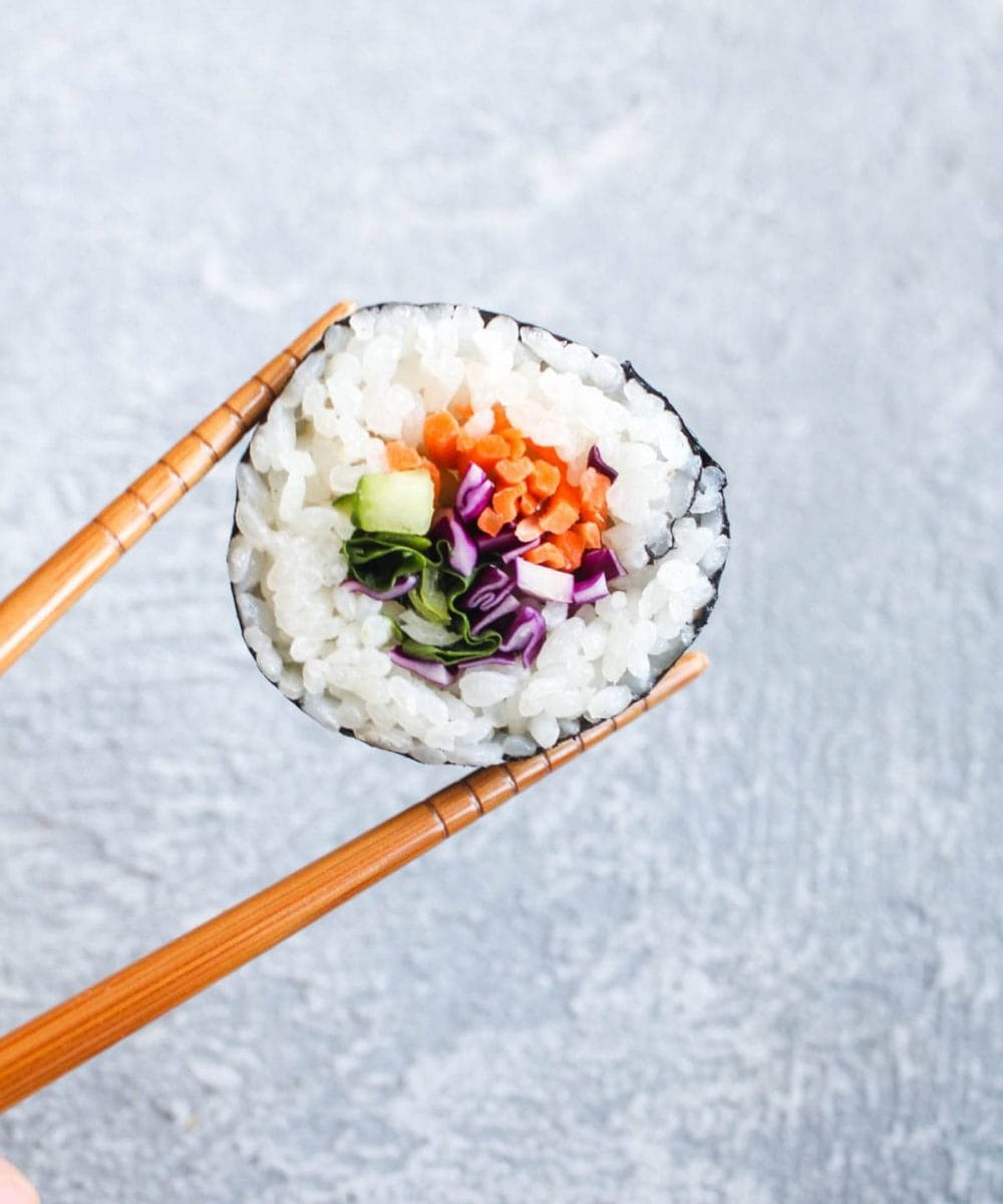 Homemade Veggie Sushi is easier than you think! Customize your roll with your favorite veggies and wow your friends by bringing the sushi bar home with this vegan and gluten free recipe.   CatchingSeeds.com