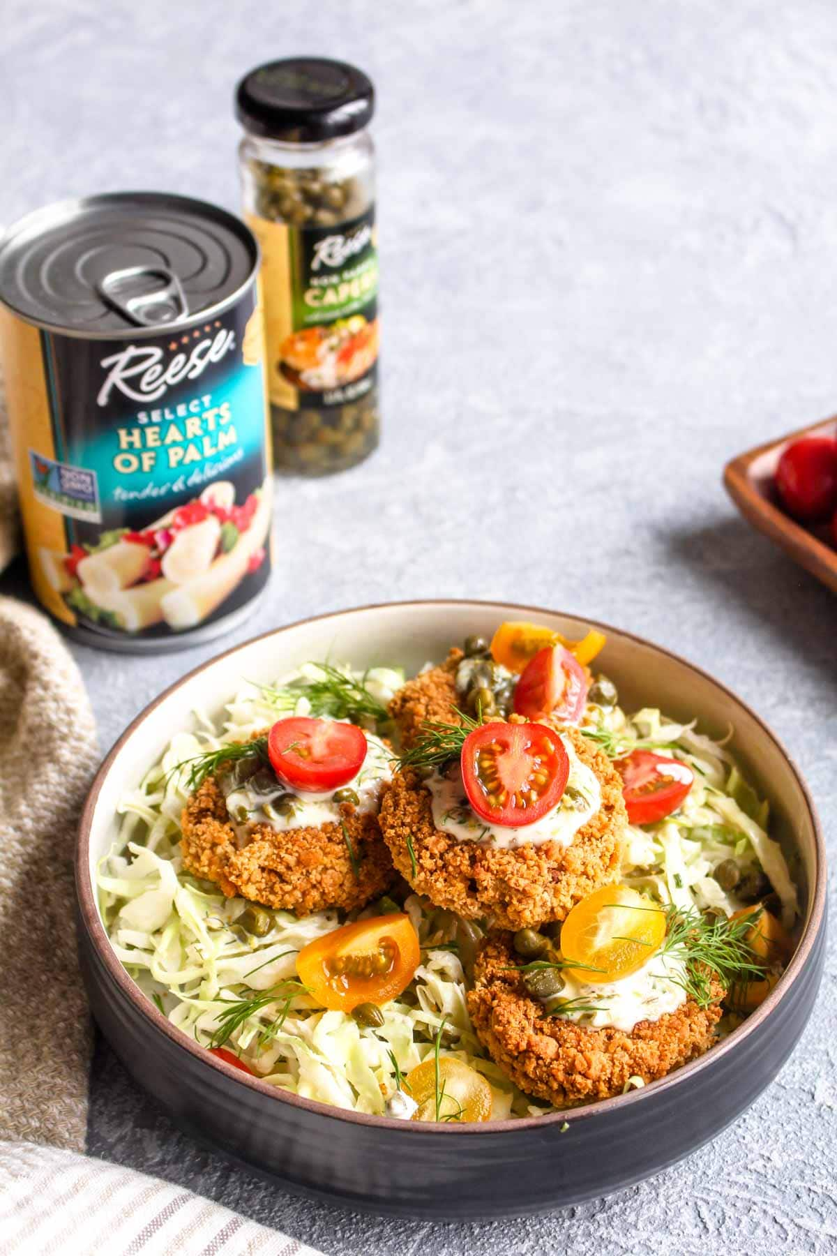 Hearts Of Palm Cakes with Caper Aioli are a fun veggie packed spin on a crab cake. This recipe is vegan, gluten, free and full of flavor! The caper aioli is the perfect bright and creamy compliment to the crispy cakes. | CatchingSeeds.com