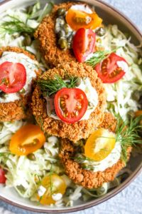 Heart Of Palm Cakes with Caper Aioli are a fun veggie packed spin on a crab cake. This recipe is vegan, gluten, free and full of flavor! The caper aioli is the perfect bright and creamy compliment to the crispy cakes.   CatchingSeeds.com