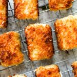 Coconut Crusted Tofu with Habanero Pineapple Sauce and Ginger Coconut Rice is a healthy recipe thats loaded with flavor. The coconut crusted tofu is cooked to golden brown perfection, drizzled with a sweet and spicy sauce, and then served atop fragrant rice. And this dish is vegan and gluten free!   CatchingSeeds.com