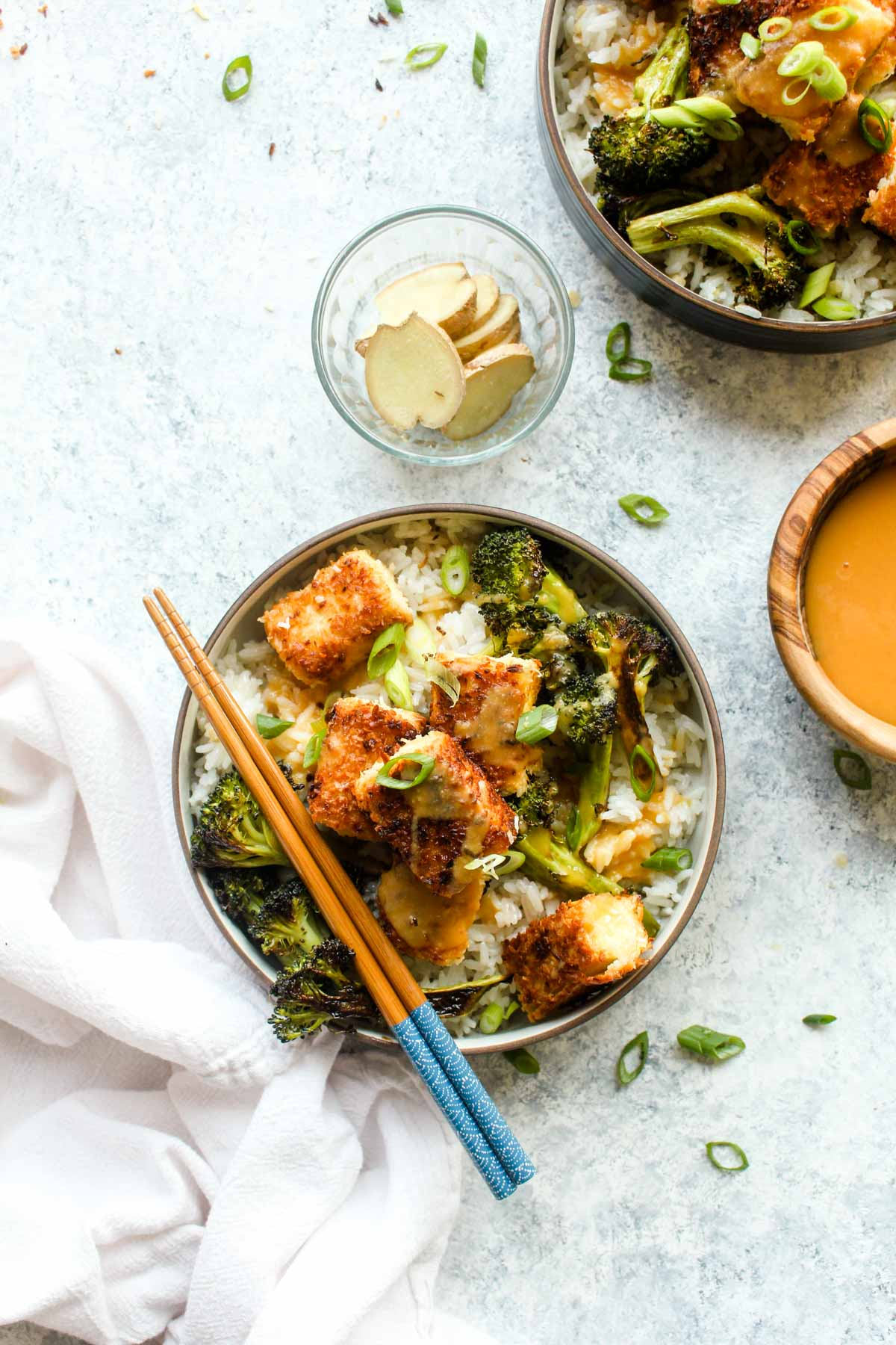 Coconut Crusted Tofu with Habanero Pineapple Sauce and Ginger Coconut Rice is a healthy recipe thats loaded with flavor. The coconut crusted tofu is cooked to golden brown perfection, drizzled with a sweet and spicy sauce, and then served atop fragrant rice. And this dish is vegan and gluten free!