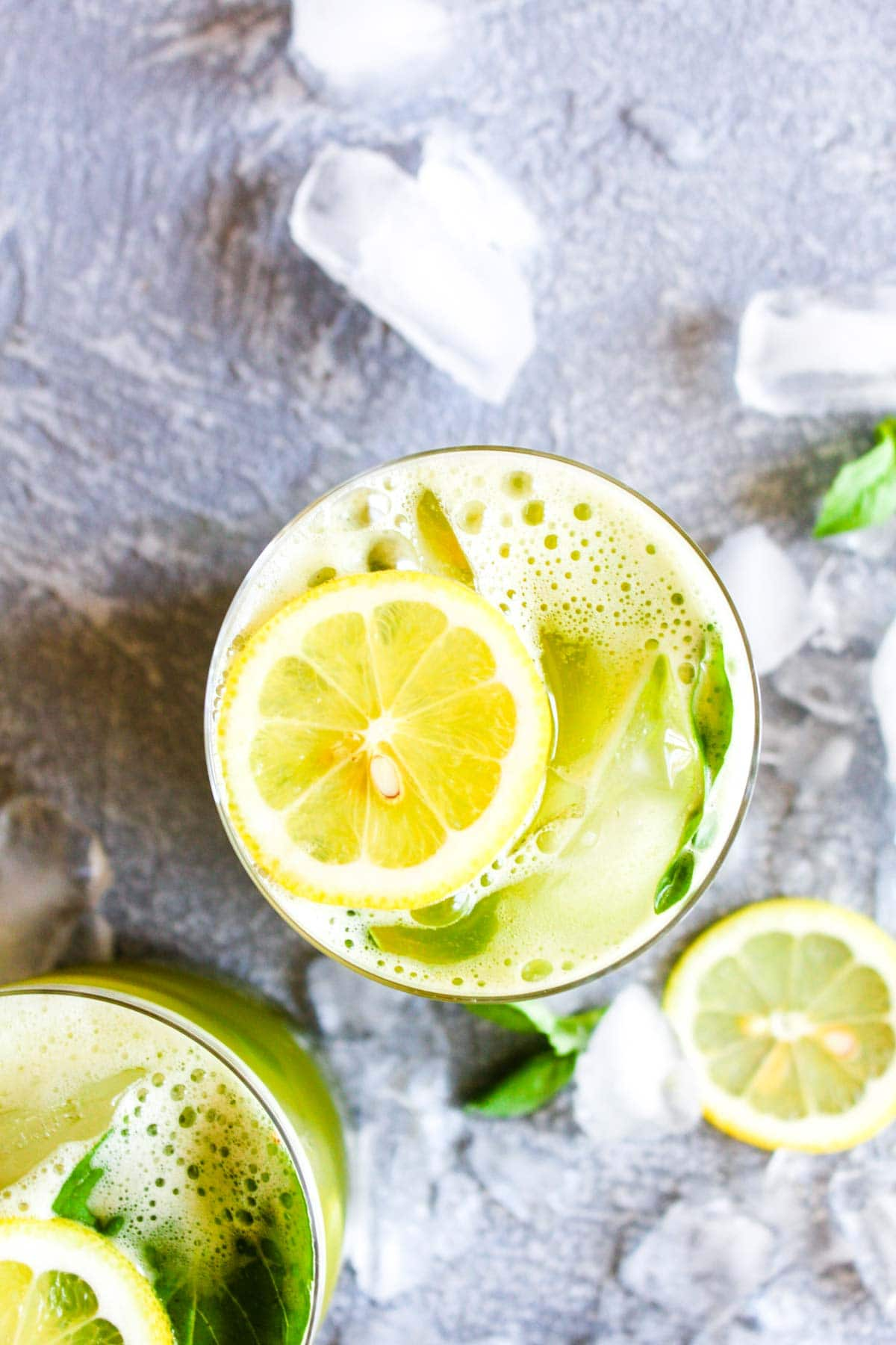 10 minute Matcha Basil Lemonade is a refreshing summer drink sweetened with honey! This healthy beverage is paleo and full of antioxidants.   CatchingSeeds.com