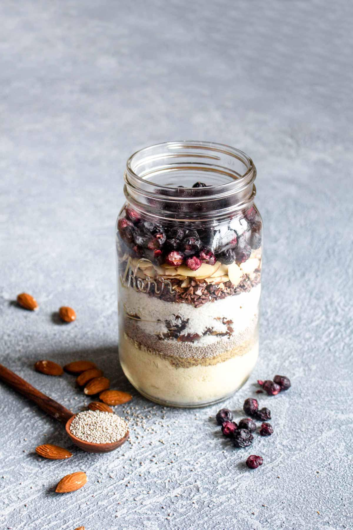 On busy mornings, you'll be thanking your lucky start that you have Paleo Superfood Cereal on deck. This healthy breakfast is packed full of nuts, seeds, and fruits for a satisfying start that will keep you full until lunch. Make a big batch in 10 minutes and then enjoy it all week. Gluten free, vegan & paleo! | CatchingSeeds.com