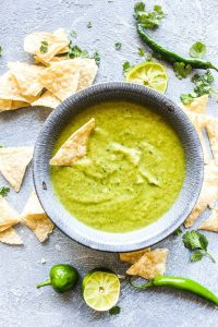 Cilantro Salsa Verde is surprisingly easy to make at home! This popular dip requires just 3 steps, and is packed with so much more flavor that the jarred stuff.| CatchingSeeds.com