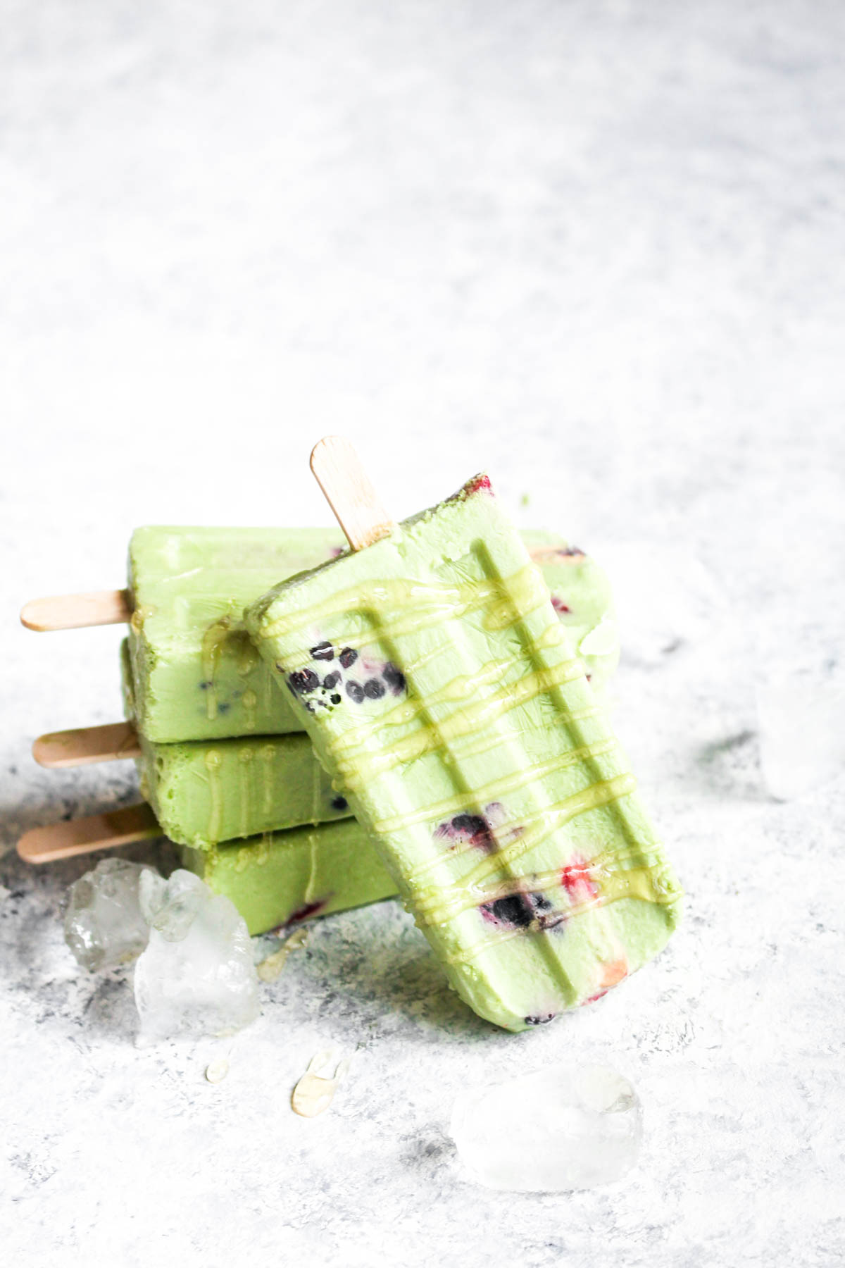 These 5 ingredient Berry Matcha Latte Popsicles with Honey Drizzle are a delicious no-cook 10 minute dessert! Made with creamy coconut milk and naturally sweetened these pops are dairy-free and paleo! | CatchingSeeds.com
