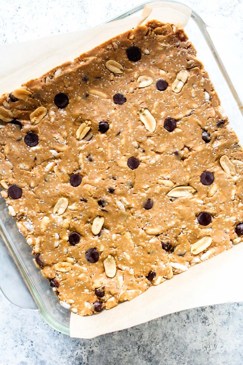 Peanut Butter Crunch Bars are a creamy, crispy, crunchy sweet treat that is healthy enough to enjoy as a snack! These gluten free bars are naturally sweetened and couldn't be easier to make. | CatchingSeeds