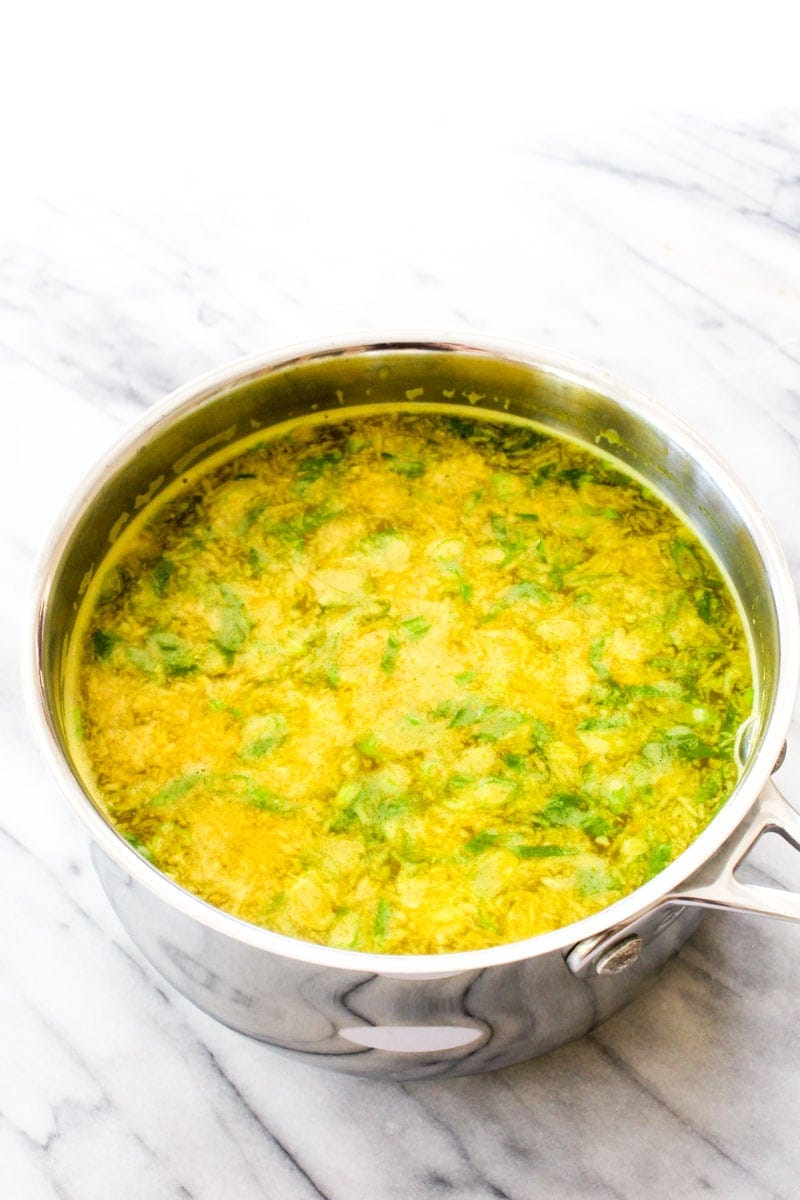A silver pot filled with immune boosting broth.