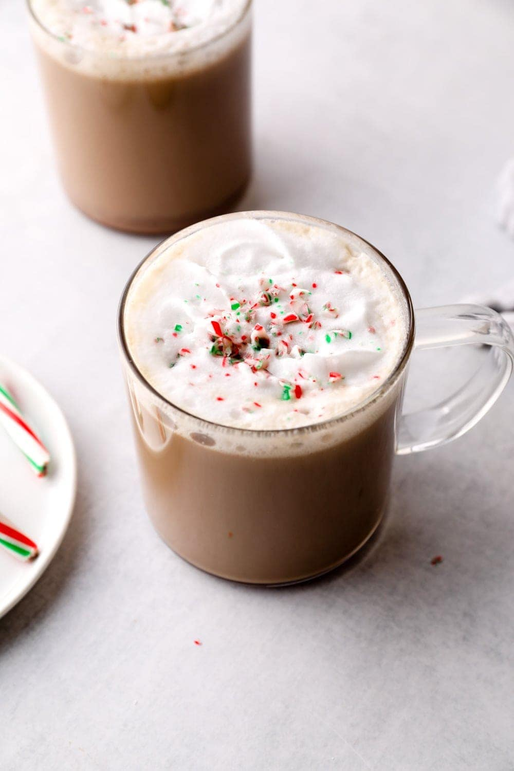 Peppermint mocha topped with coconut whipped cream and crushed candy canes.