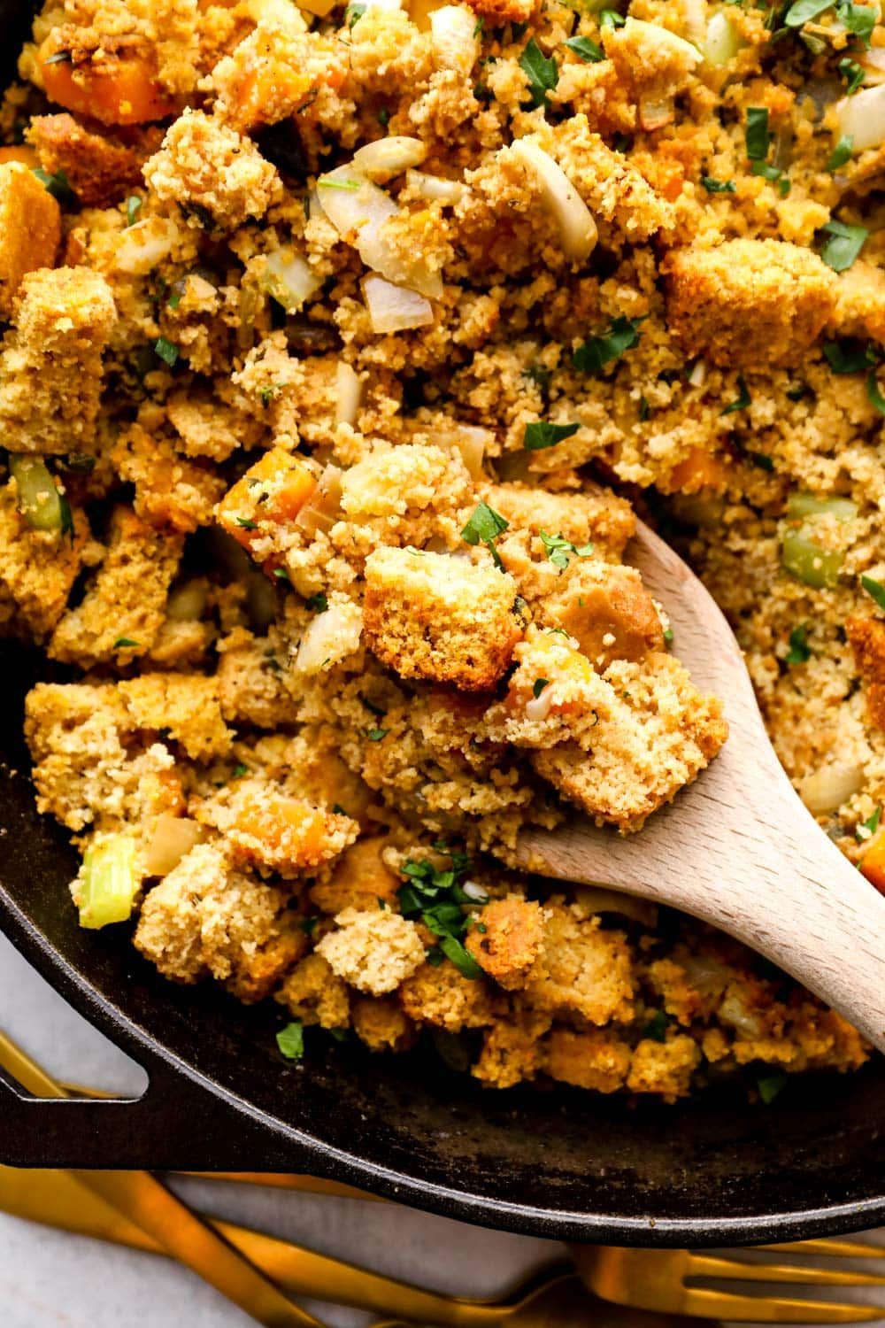 Gluten Free Cornbread Stuffing being spooned out of the pan.