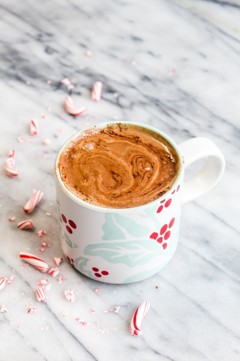 A healthy peppermint mocha in a mug with crushed candy canes.