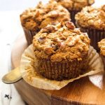 Gluten Free Morning Glory Muffins on a wood board.