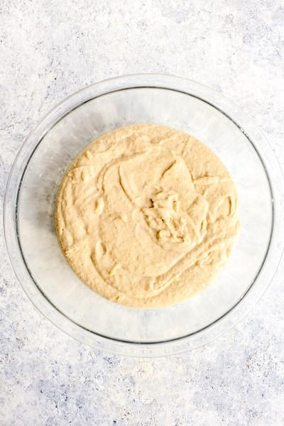 Gluten free pizza crust dough in a glass bowl.