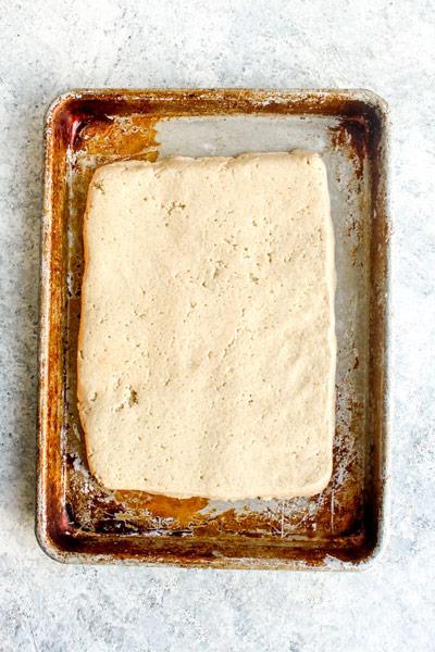 Gluten Free breadstick dough on a sheet pan.