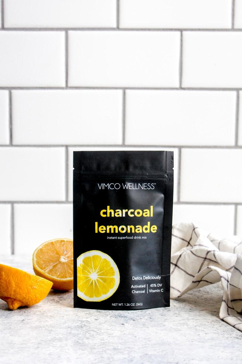 A bag of detox charcoal lemonade on the counter.