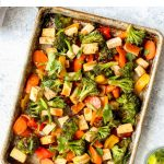 Sheet Pan Honey Sriracha Tofu and veggies on a sheet pan.