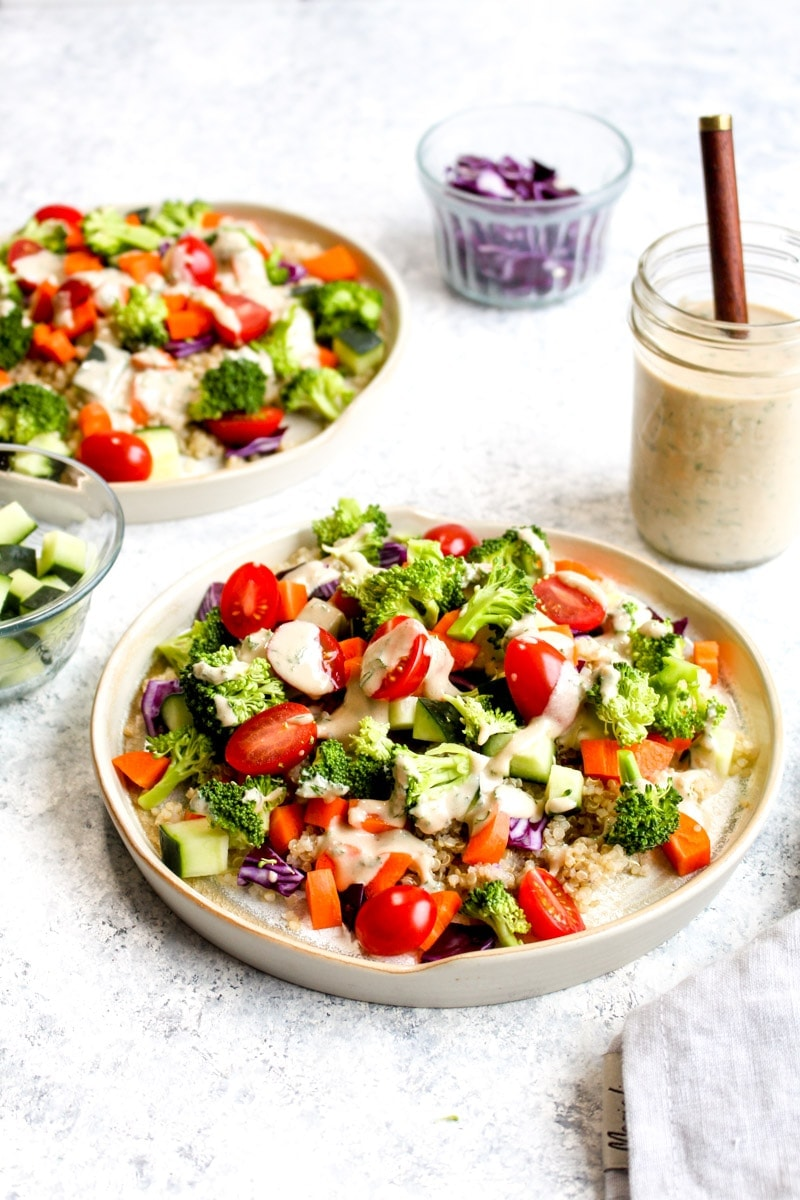 A salad topped with tahini ranch dressing.