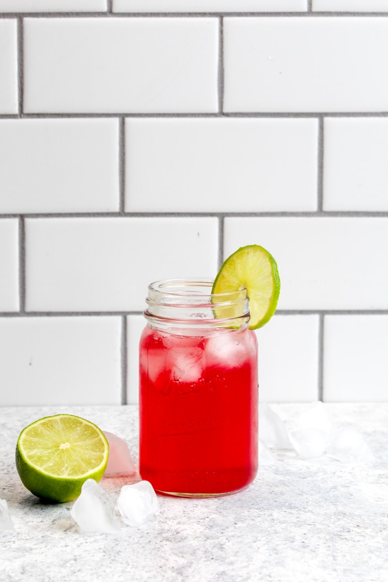 Pomegranate lime real fruit sparkling water in a mason jar.