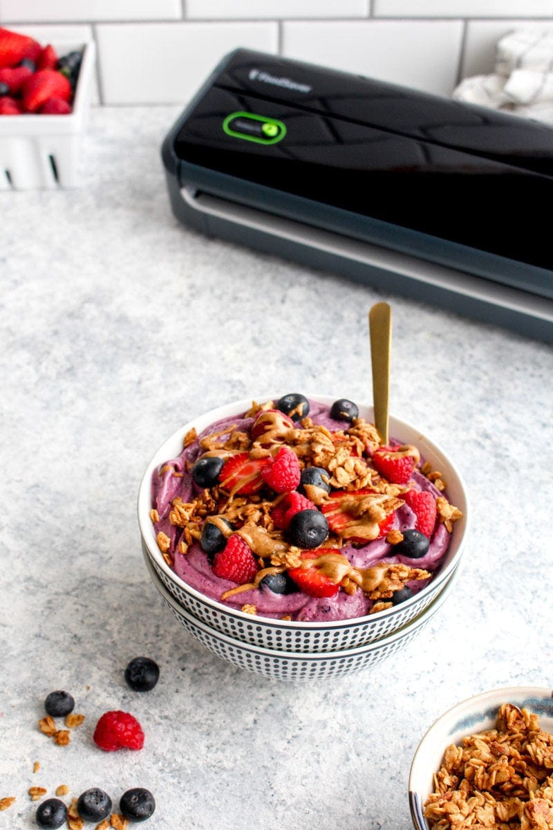 A meal prep berry crisp smoothie bowl topped with a FoodSaver.