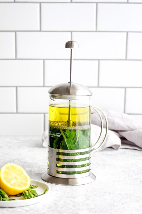 Fresh mint tea being made in a french press.
