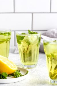 A glass of fresh mint tea over ice.