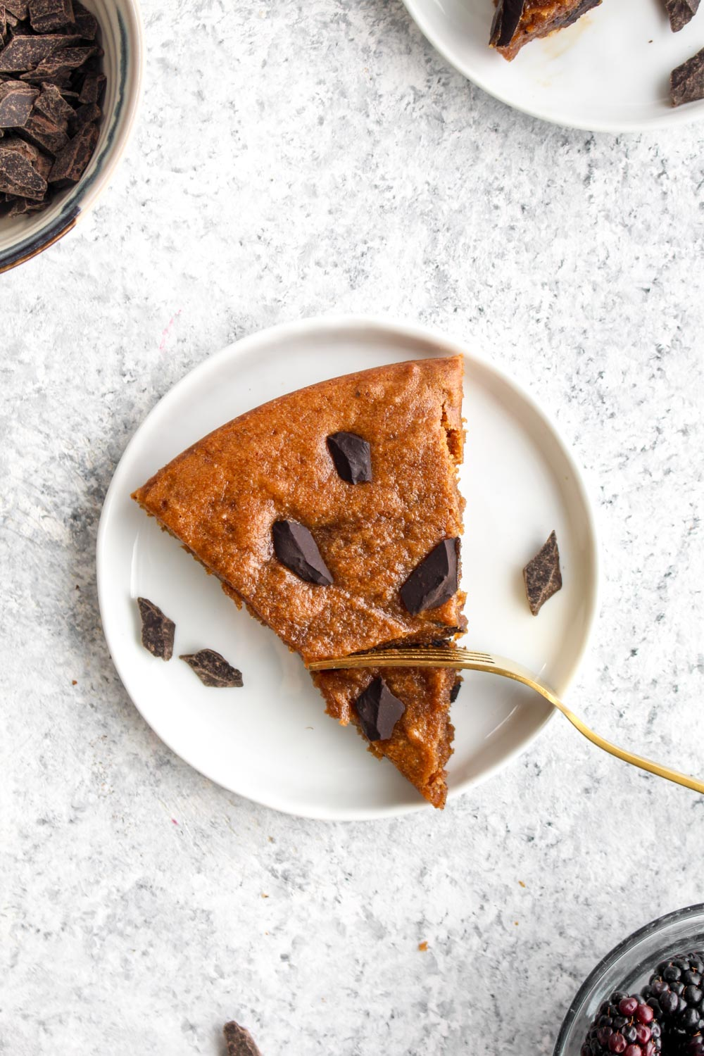 Almond butter chip snack cake with chocolate chunks and a gold spoon.