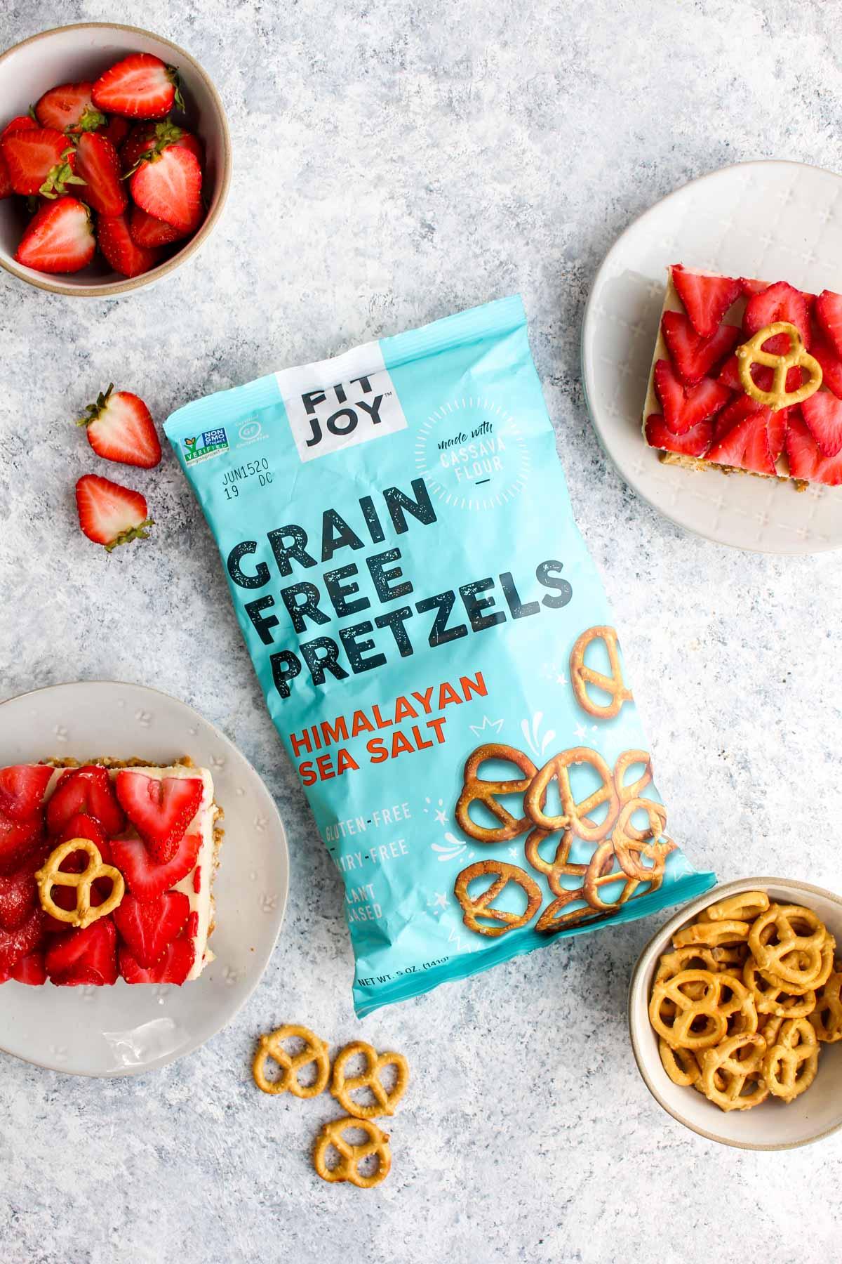 A bag of grain free pretzels and several slices of healthy pretzel salad.