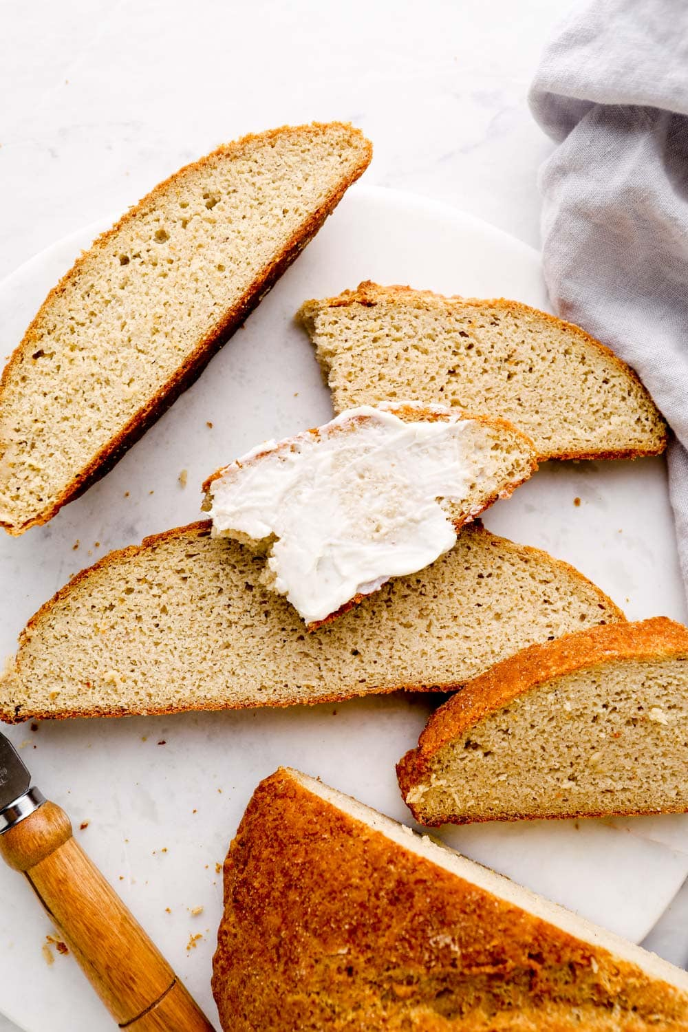 Artisan Gluten Free Bread spread with butter.