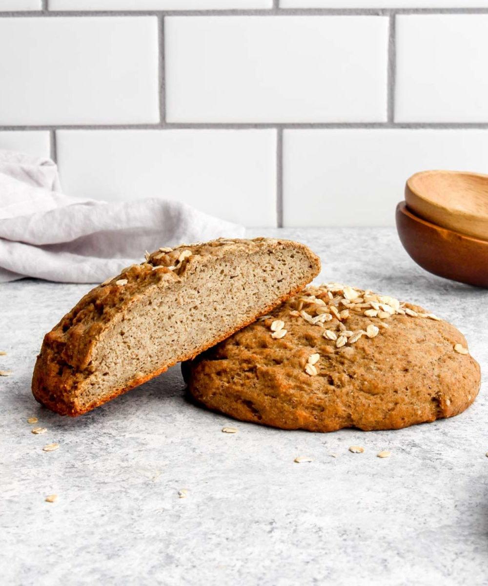 A loaf of 100% whole grain gluten free bread cut in half.