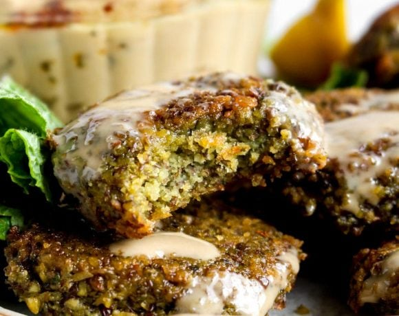 A bite out of a baked lentil falafel with herbs.