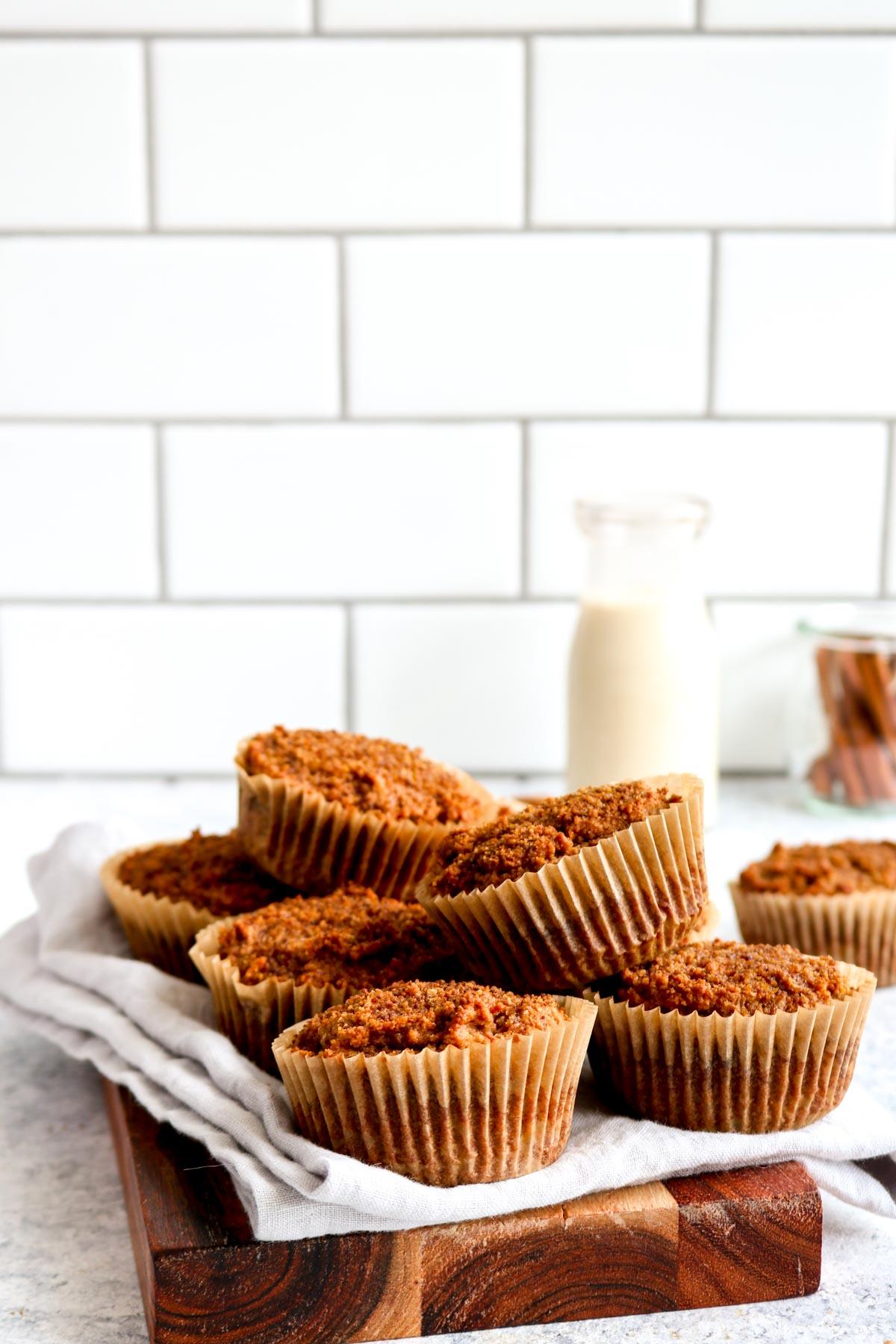 Simple paleo pumpkin muffins on a cutting board.