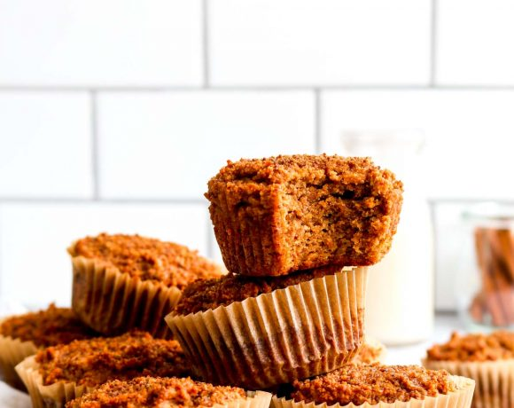 A bite out of a simple paleo pumpkin muffin with cinnamon.