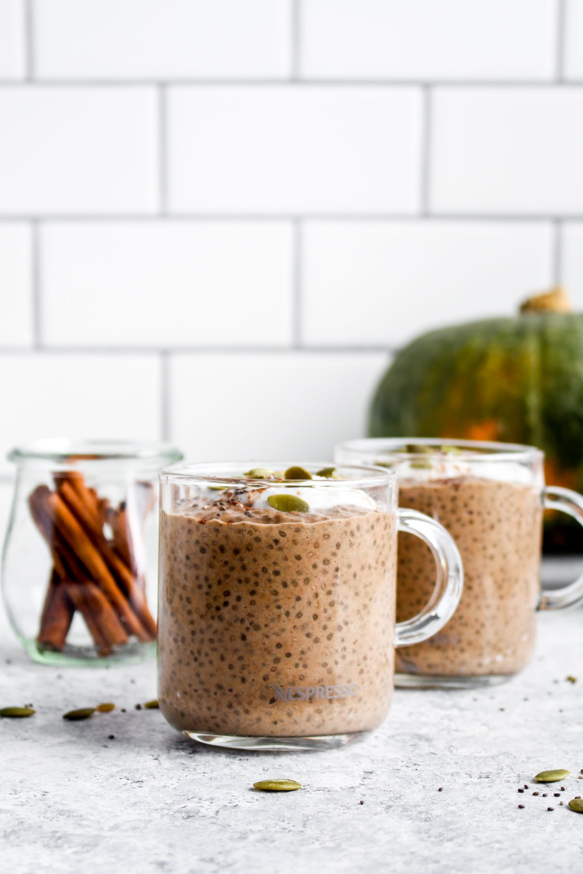Two coffee mugs filled with Pumpkin Spice Latte Chia Pudding.