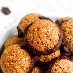A paleo pumpkin spice macaroon cookie with coconut.