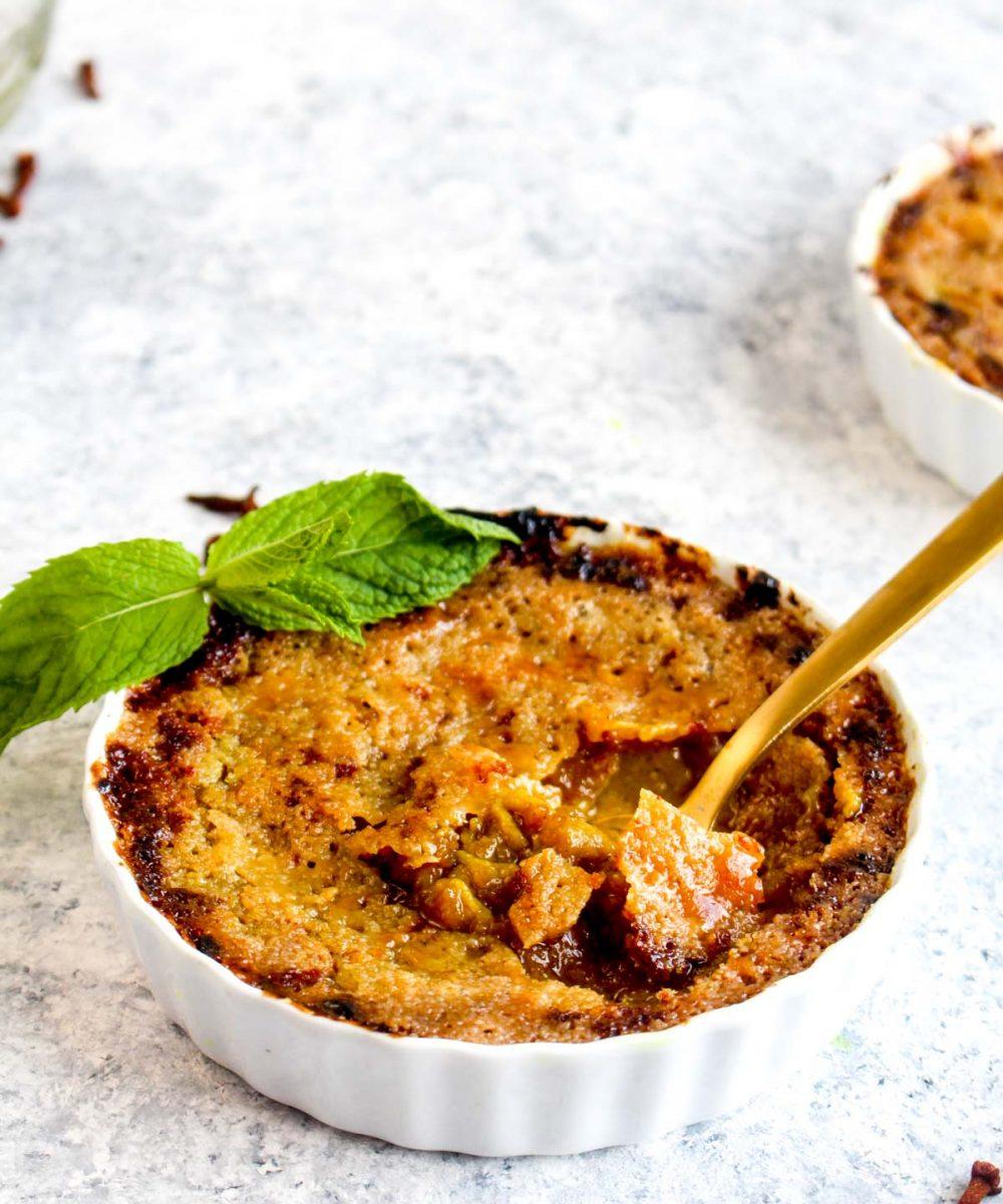 Vegan Pumpkin Creme Brulee in a ramekin with burnt sugar.