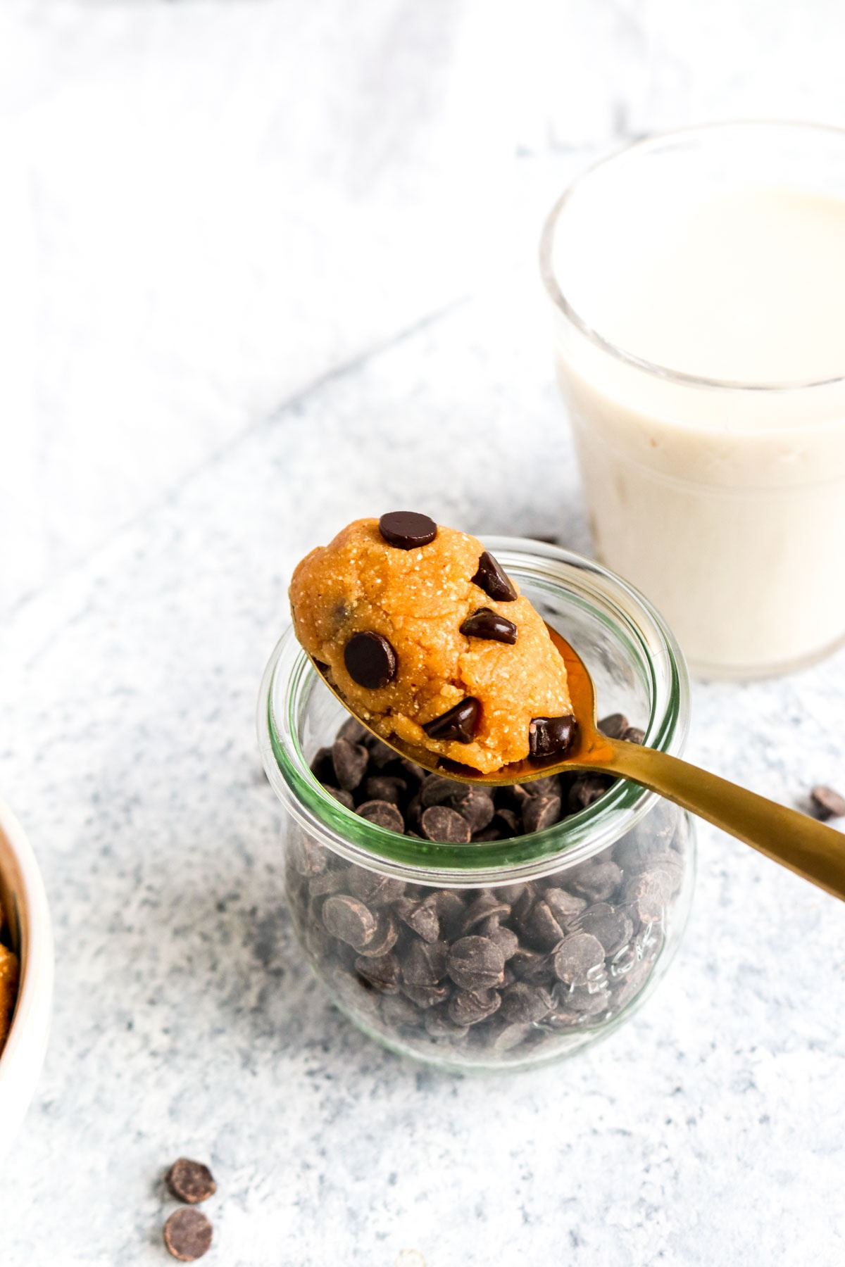 Edible grain free gookie dough on a spoon with chocolate chips.