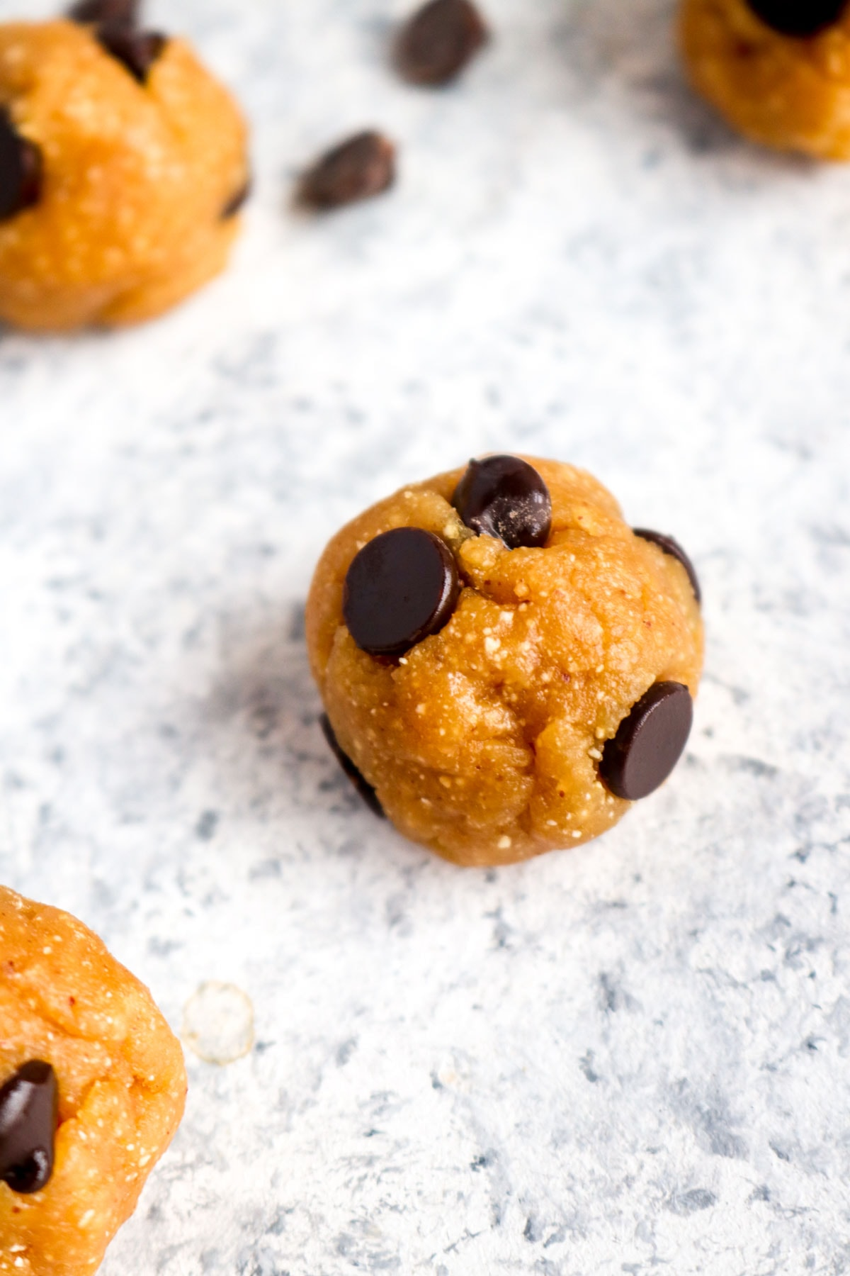 Edible grain free cookie dough rolled into a bite sized ball for easy snacking.