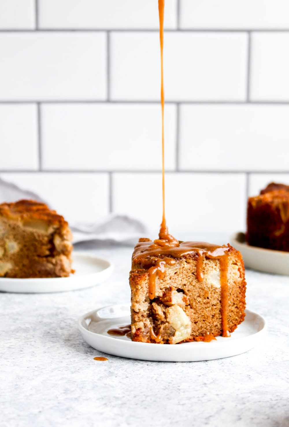 Caramel being drizzled on paleo pear cake.
