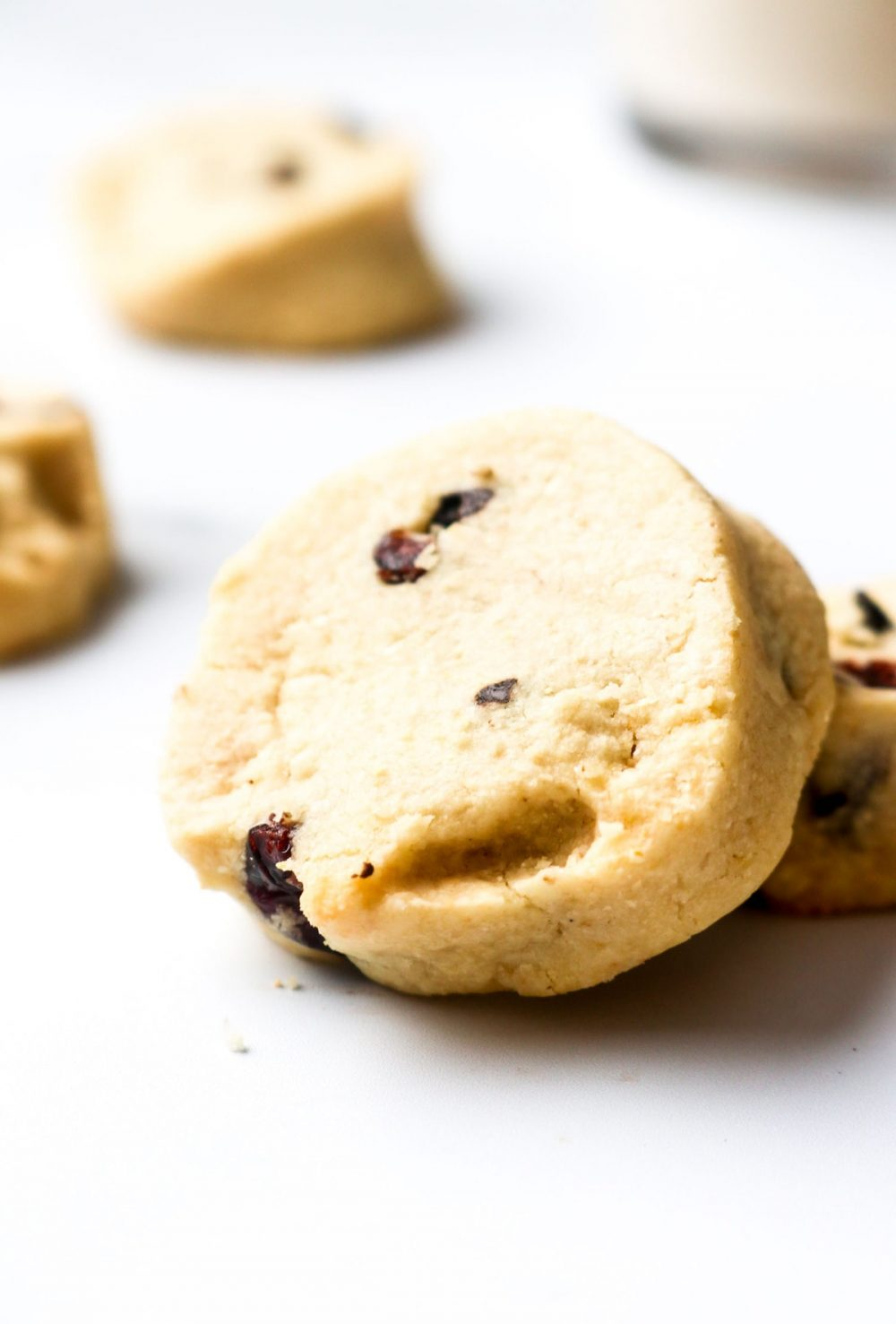 Two chocolate chip cranberry shortbread cookies.