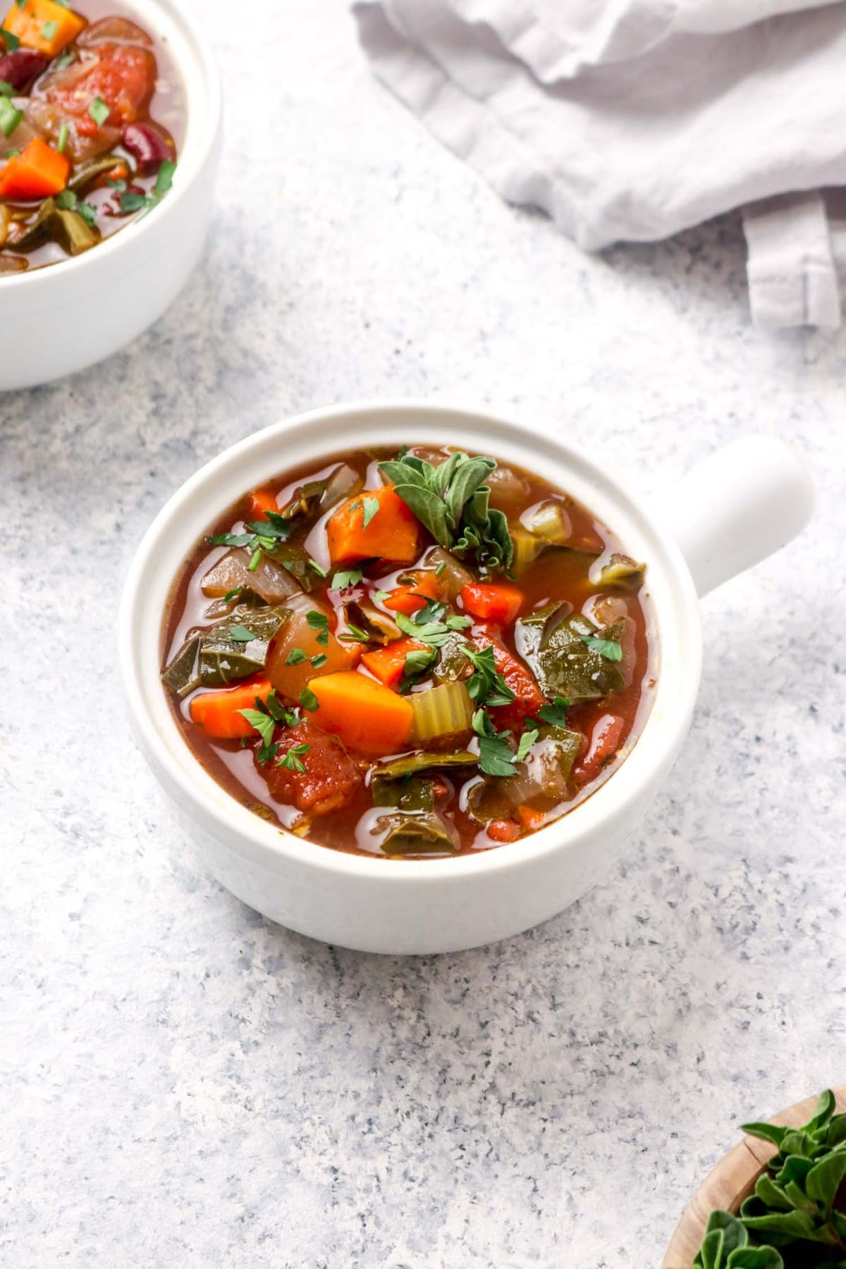 A bowl of easy Balsamic Vegetable Soup with herbs.